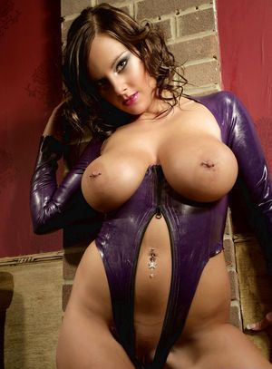 Stunning MILF Cnady in latex with naked big tits spreading to rub her clit