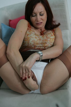 Mature dykes taunt each other in granny panties and tan nylons