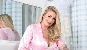 Mature beauty Danielle Maye flaunts her big tits & stretches wide in stockings