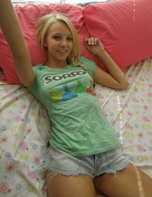 Cute blonde teen snaps self shots of her bare boobs in cutoff jean shorts