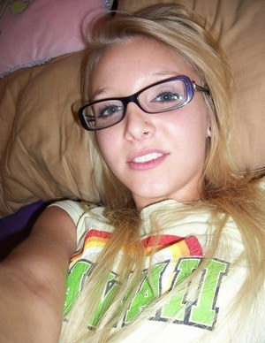 Nerdy teen girl takes selfies of her exposed tits and micro shorts