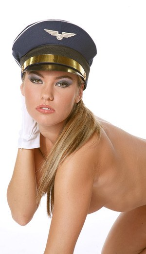 Hot solo girl peels off her pilots uniform with hat and gloves on