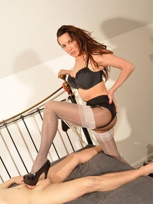 Mature mistress Nylon Jane torments blindfolded slave with heels & stockings