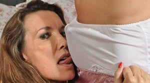 Hot mature mistress Nylon Jane binds her slave & tortures him with her tongue