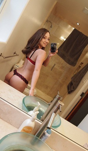 Amateur solo girl takes nude selfies in and out of the house