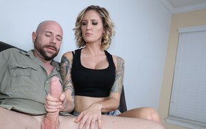 Sexy tattooed girl Reagan Lush gives a perfect handjob and gets facialed
