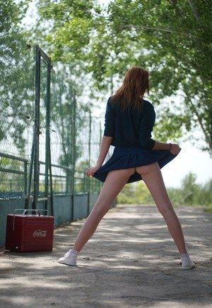Hot redhead Elen Moore flashes sexy upskirt walking to cheerleader practice