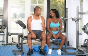 Beautiful ebony fitness girl Osa Lovely rides her instructor on top at the gym