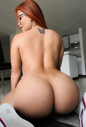 Colombian redhead Ms Monroy flaunts her big booty as she strips to knee socks