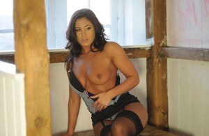 Brunette glam model Miss Amorette shows her nice tits and twat in nylons