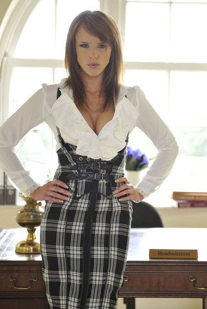Headmistress Mackenzie exposes her tits and ass while changing attire