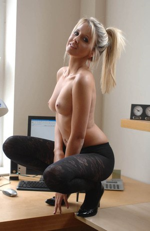 Hot blonde secretary Secretary Rachel undresses at her office desk