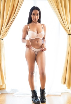 Hot and busty ebony girl with perfect ass sheds hot underwear to pose in boots