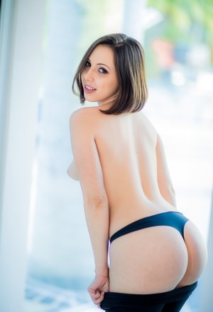 Solo girl Jenna Sativa finishes getting naked by removing skin tight leggings