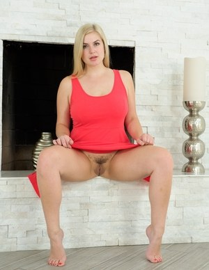 Lonely amateur blonde Danielle lifts her dress up and shows big ass and pussy