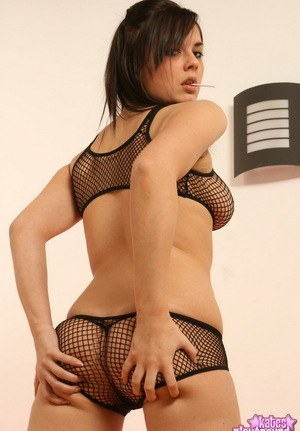 image Kinky pink fishnet girlfriend on the couch