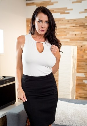 Brunette cougar Reagan Foxx uncovers her big boobs before sex with younger man