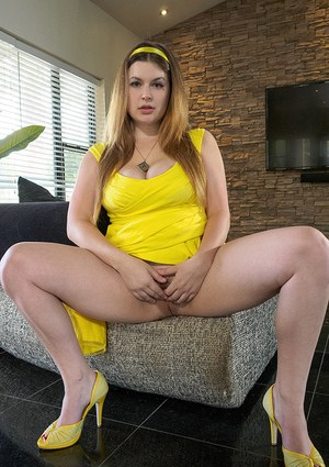 Natural redhead hikes up her yellow dress to expose her ass and snatch