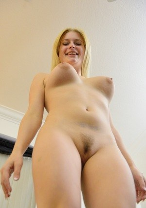 Blonde amateur whips out her natural boobs before toying her pink snatch