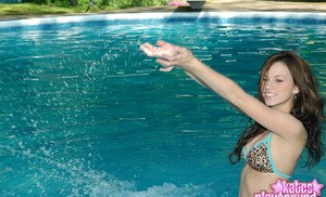 Teen first timer models non nude in a string bikini out in the pool
