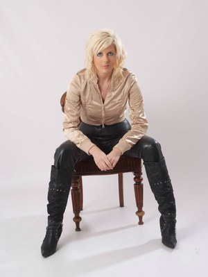 Classy model flashes her underwear as she unzips her leather pants