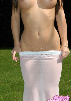 Young amateur model teases on the lawn in a revealing clothing
