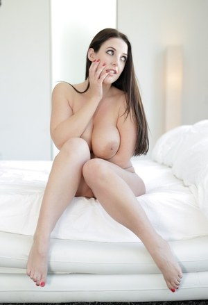Busty Angela White poses with massive big tits bare in interracial session