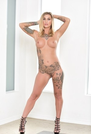 Hot solo model Kleio Valentien peels off a cat suit to pose in the nude