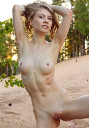 Skinny girl Eva Gold naked showing close up shaved pussy outdoors on her knees