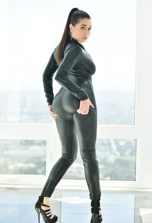 Brunette chick Karlee Grey unzips a leather catsuit in order to pose nude