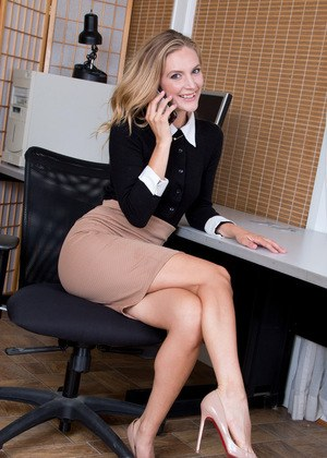 Sexy secretary Mona Wales strips off tight skirt on way to posing in the nude