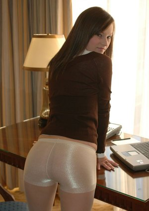 Attractive amateur office girl Kate strips down naked at work