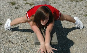 Amateur girl Kate displays upskirt thong in cheerleader outfit on wooden bench