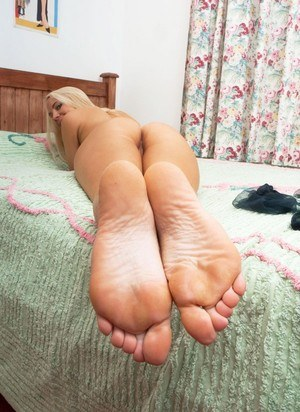 Smiley blonde Taylor Shay shows her sexy feet close up in black nylons & nude