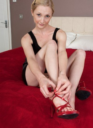 Petite blonde Lil Chloe licking her sexy toes and flexing bare feet close up