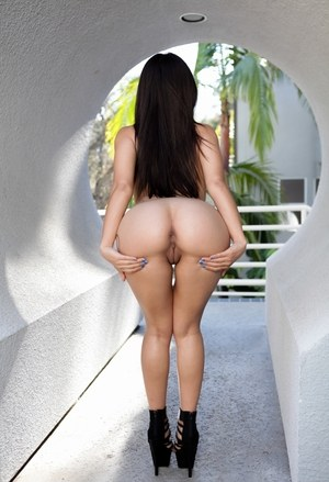 Beautiful Latina pornstar Jynx Maze spreading ass naked wearing high heels