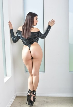 Hot solo girl Valentina Nappi strips off her leather onesie to model nude