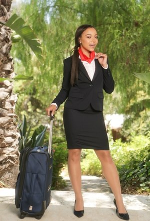 Beautiful ebony flight attendant pauses in the sun to shed her uniform