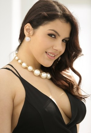 Brunette solo girl Valentina Nappi set her nice tits and ass free from dress
