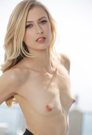 Exotic blonde pornstar Alexa Grace strips at the top of the building