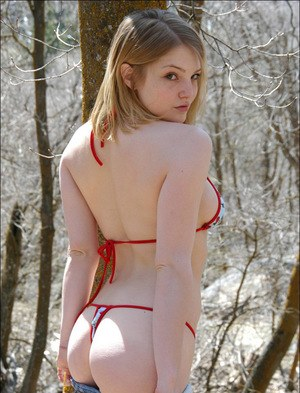 18 year old cutie poses in the woods wearing the skimpiest of bikinis