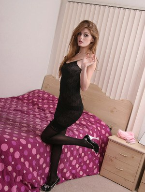Ginger teen Faye Reagan flirting in her sexy black lace outfit
