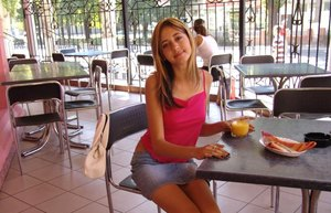 Petite teen girl poses non nude in a denim skirt at a juice bar