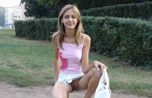 Petite teen amateur flashes a no panty upskirt in a public park