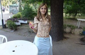 Young blonde amateur eating ice cream posing non nude in public