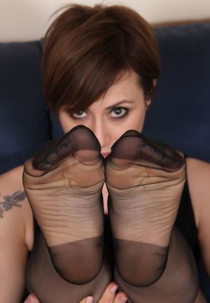 Tattooed female with short hair removes high heels from RHT nylon clad fet