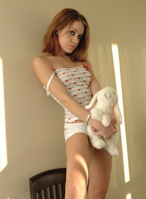 Beautiful young redhead Serena removes her top to pose in white panties