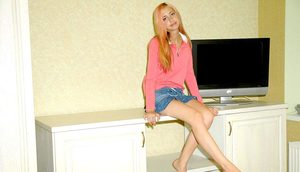 Sweet young teen climbs on her desk to flash hot panty upskirt