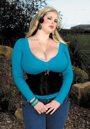 Large BBW Ashley Sage Ellison in jeans teasing with big tit cleavage outdoors