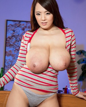 Sweet Japanese chick lets her huge big tits loose to pose topless in underwear